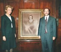 Luisa Fernanda Rudi, President of the Parliament next to her portrait and Urbano Galindo