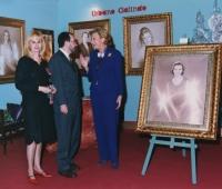 Luisa Fernanda Rudi, President of the Parliament next to her portrait, Urbano Galindo and his spouse Eugenia
