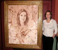 Elvira Fernández de Rajoy  next to her portrait  at an exhibition of the artist